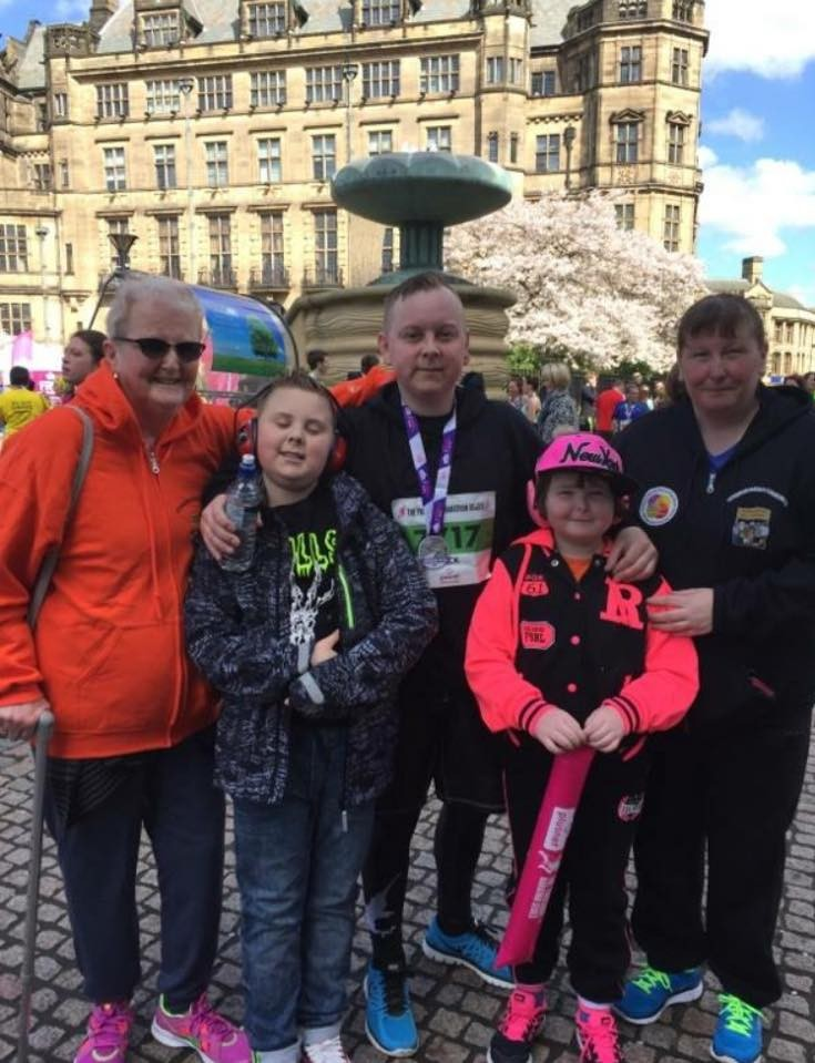 2 ladies stand with a dad and 2 children celebrating his completion of the Sheffield 10k
