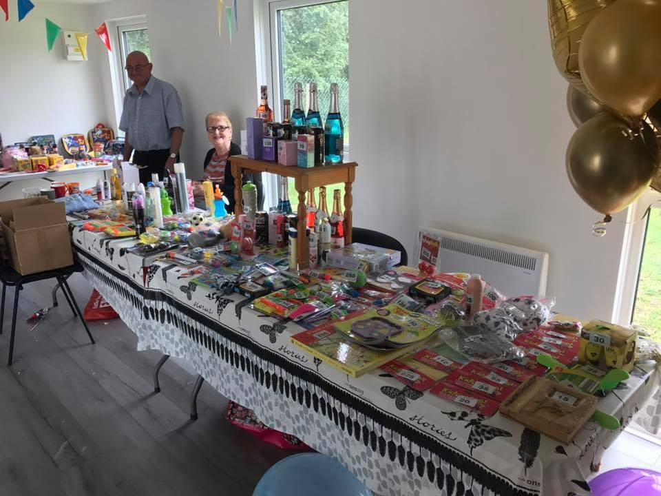 Tombola prizes set up on a stall