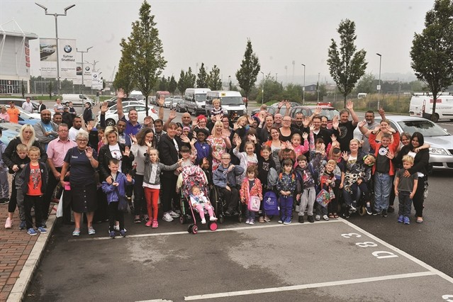 Families and Taxi drivers wave goodbye before setting off to the seaside
